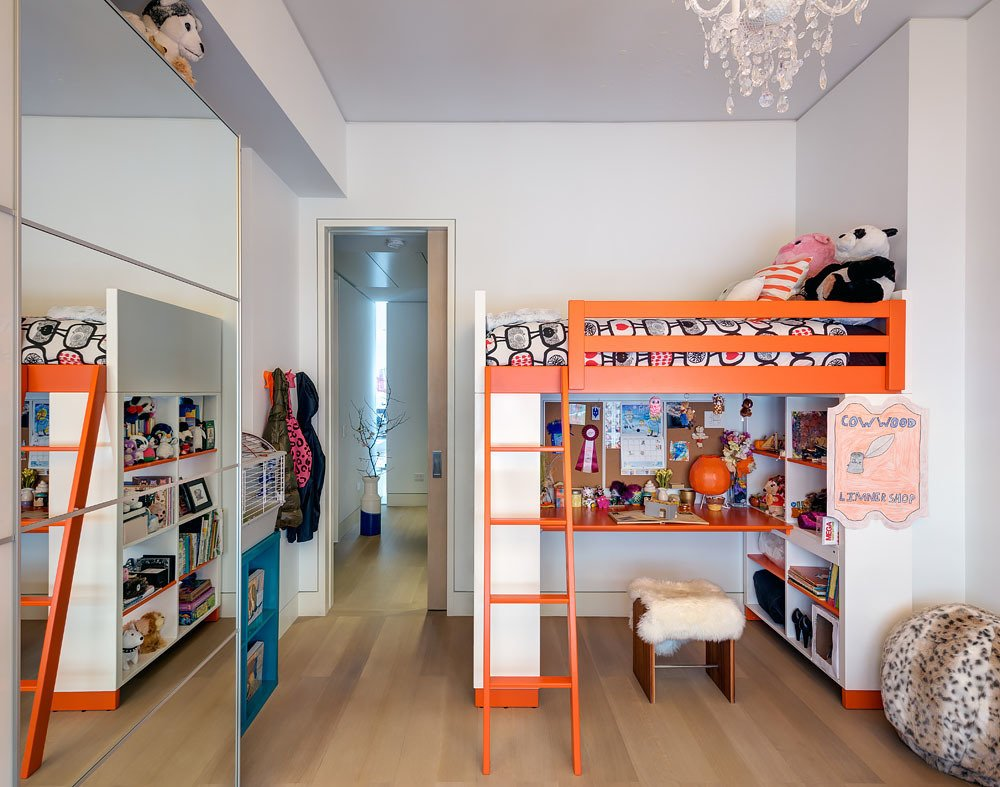 The kids' bedroom features playfully colored bunk beds from Ikea. The mirrored closet doors reflect light and make the room appear larger. The vertical light slot can also be viewed through the bedroom corridor. Tagged: Kids Room, Bedroom, Bed, and Bunks.  Bedrooms by Dwell from Ways to Design with Ikea Furniture