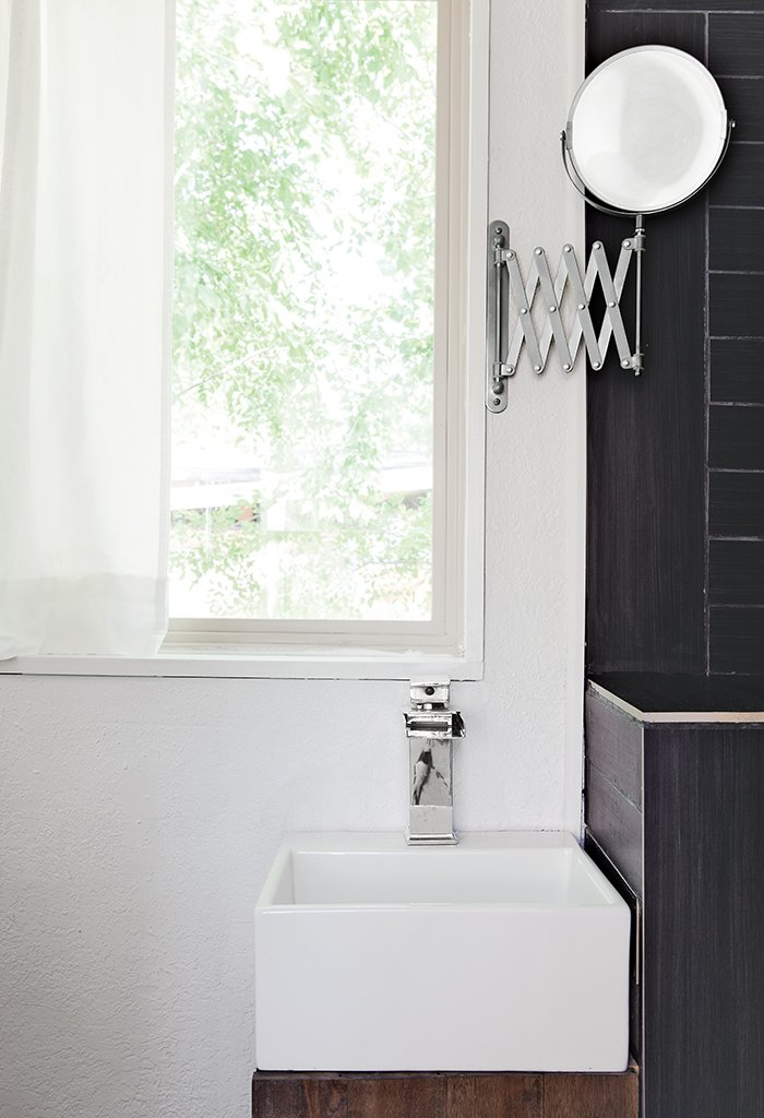 Bath Room and Vessel Sink In the bathroom, a chrome waterfall faucet by LightInTheBox tops a 12.6-inch-square Mini Nova basin by Barclay; a retractable Ikea mirror is the only concession to vanity.  Photo 3 of 4 in Tiny House Fits a Family in 196 Square Feet