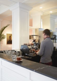 Grab a cup of coffee from Bolt, located next to the seating area.