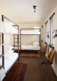 "Hostel-style bunks are available in the hotel. ""We liked the idea of creating a democratic hotel, where members of a band playing down the street or a student coming to visit RISD would feel as comfortable as the parent of a Brown student accustomed to luxury digs,"" Heckman says. ""The idea of these different characters with different budgets rubbing shoulders in the hallways and lobby is very exciting to us."""