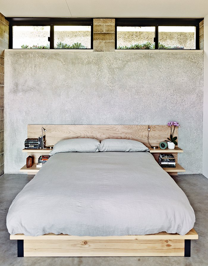 """Bedroom, Night Stands, Concrete Floor, and Bed The master bedroom sports a custom birch bed.  Search """"sustainable rammed earth home new mexico"""" from Ingenious New Building Method Replaces Concrete Block with Rammed Earth"""