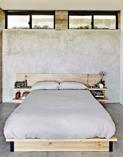 The master bedroom sports a custom birch bed.