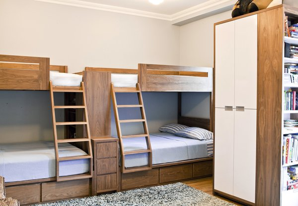 "Urbangreen selected walnut wood coated in a clear, low-VOC finish for the custom bunk beds. ""It brings out the natural beauty and detail of of the grain,"" says Elias Didaskalou of Urbangreen. ""The materials used not only had to look good, but also had to ensure durability and longevity. Sustainability for Urbangreen, along with lowering our carbon footprint, also means handcrafting pieces that last a lifetime: Non-disposable furniture that will not end up in a landfill."""