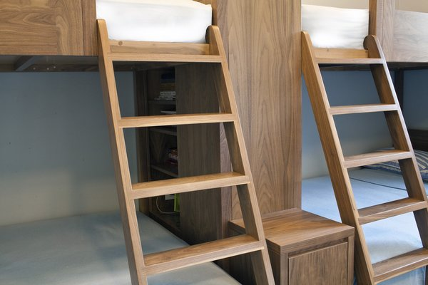 "Cubbies tucked into the frame offer additional storage. One of the details Didaskalou likes most about the design is ""the flow of the ladder from the top twin bed to the bottom full bed.""   Click here to discover more stories about modern bunk beds."