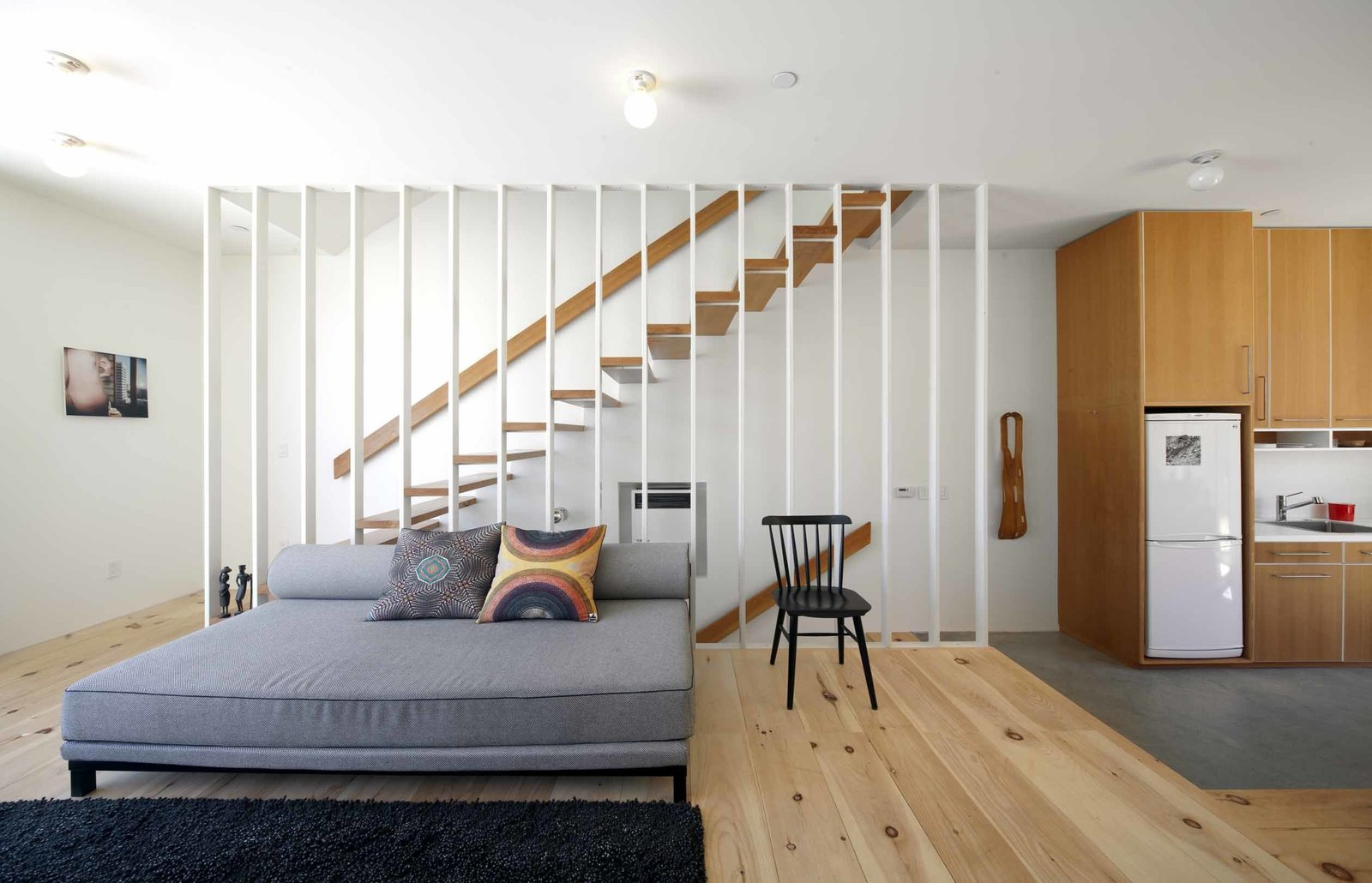 """My number one concern was to make it feel like a normal house [despite its restricted layout],"" says Storey. ""You're stuck with a box, and if you want to get creative with that, it's only going to make it a smaller box. Even the stairwell, which filters light into the core of the house, is a chunk of space I've taken away from it. It's unusual how small the house looks on the outside compared to how big it feels inside.""  Photo 3 of 9 in Home and Studio Maximizes Very Narrow Site in Echo Park"