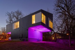 On a wooded plot in Arkansas, the architecture firm Silo AR+D erected a radiant live-work home that announces its nocturnal presence by projecting colored light from concealed LED fixtures. The home's tone can be manipulated and controlled via smartphone.