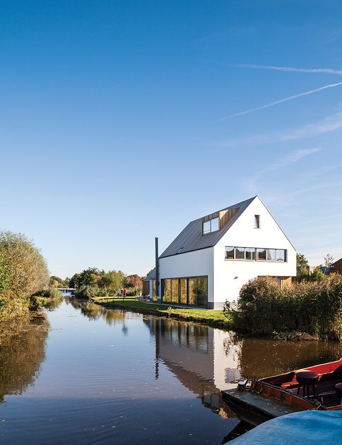 Exterior, Gable RoofLine, Shingles Roof Material, and House Building Type The newly built house, just feet from the water's edge, occupies the space where a decaying farmhouse once stood.  Roofs by Aileen Kwun from A Modern Take on the Pitched-Roof