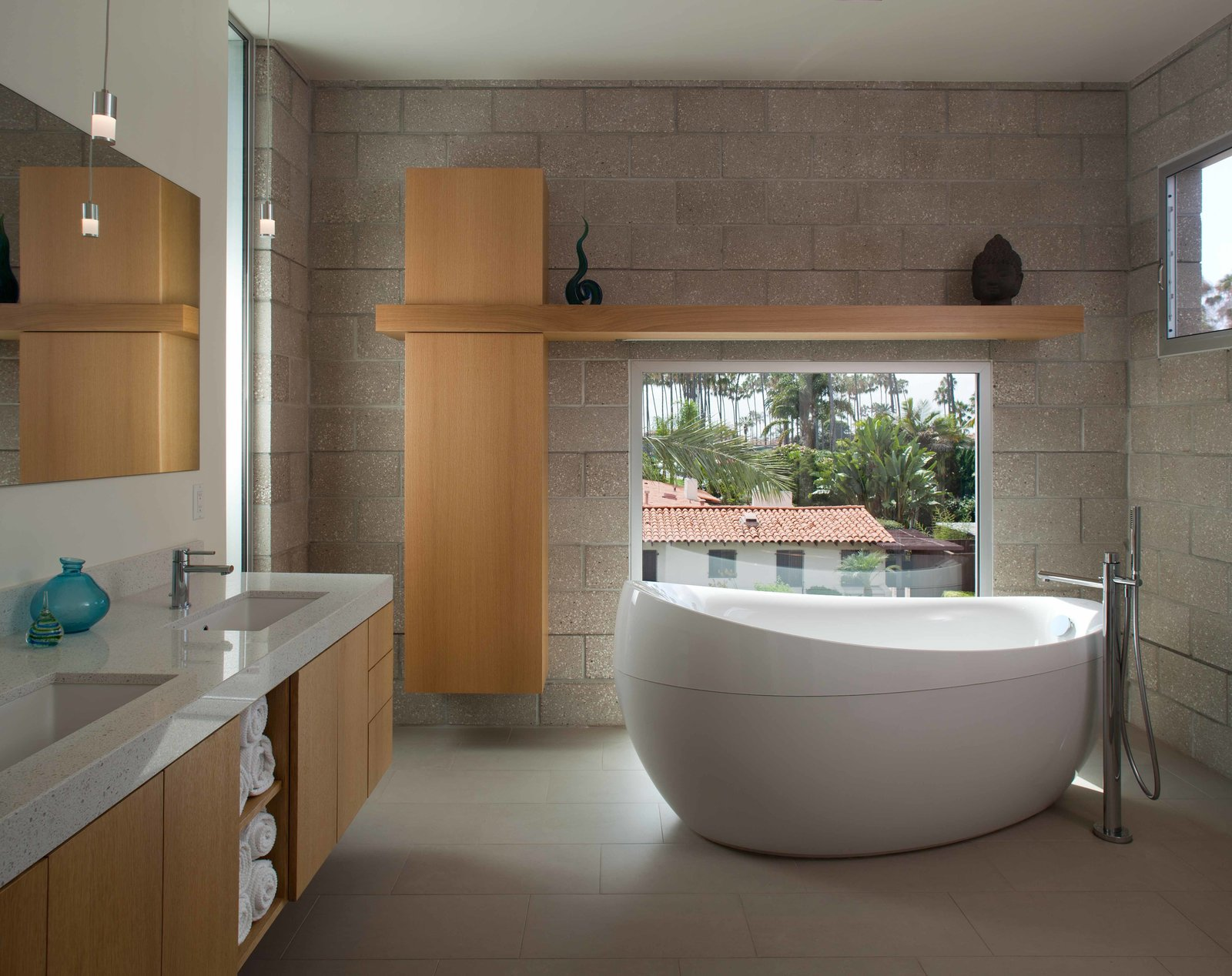 Bath Room, Freestanding Tub, Pendant Lighting, and Undermount Sink Windows are scattered throughout the house in order to let in natural light wherever possible, while custom furniture with clean, minimal lines contributes to the natural palette.  Photo 2 of 7 in Green Home in La Jolla Blends Indoors and Outdoors
