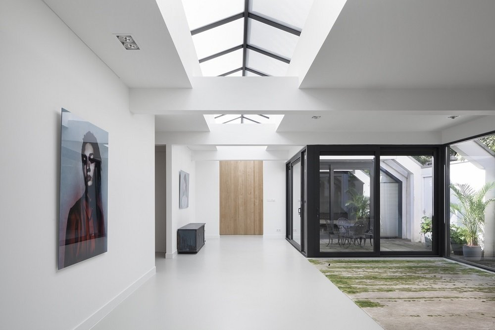 Jaspar Jansen and his team at i29 used strategic touches to bring nature indoors while renovating this former garage, such as adding an enclosed patio and custom rugs meant to recreate the look of moss.  Minimal Home Recreates Nature in the Heart of Amsterdam by Patrick Sisson