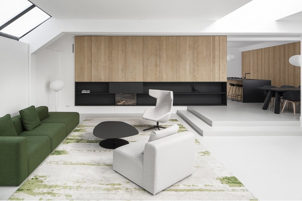 A black accent line stretches across the space like the horizon, a feature Jansen utilized to connect the living room and kitchen.  Minimal Home Recreates Nature in the Heart of Amsterdam by Patrick Sisson