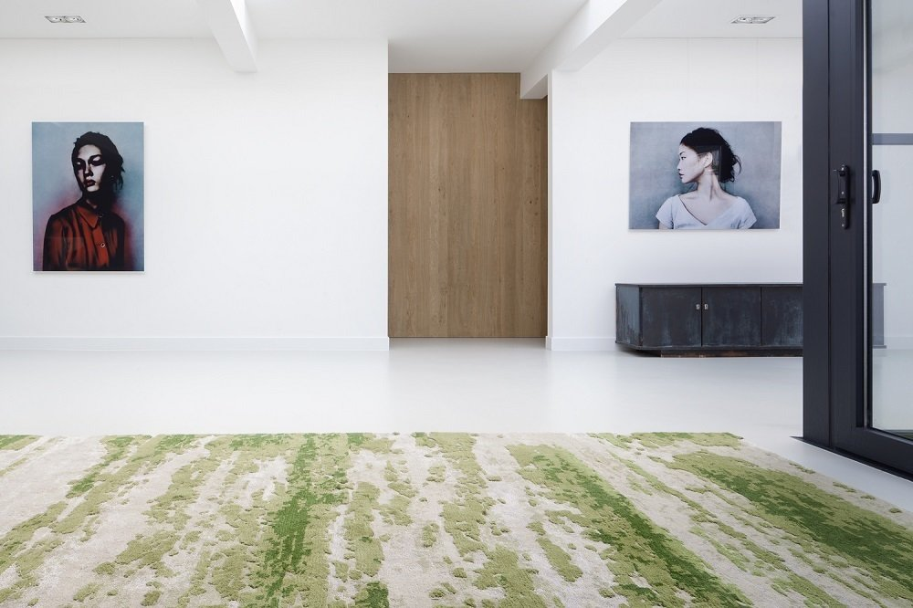 The custom rug adds a mossy, green color pattern and texture (without the need for regular watering).  Minimal Home Recreates Nature in the Heart of Amsterdam by Patrick Sisson
