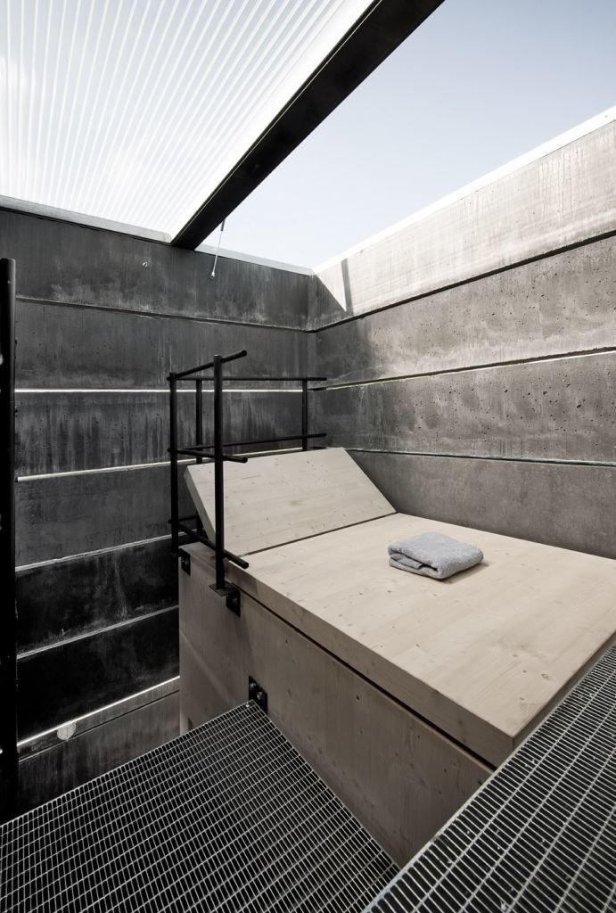 """The top level contains a wood lounge with a retractable roof.  Search """"five open decks"""" from Inside This Modern Tower Is an Idyllic One-Man Sauna"""