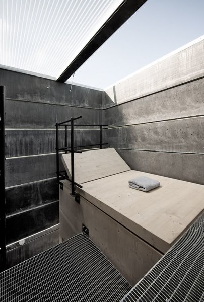 The top level contains a wood lounge with a retractable roof.