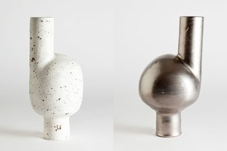Two examples of Kaiser's irreverent Wayward vase silhouette. In the version at left, the cylinder plus sphere combo has a textured surface made by treating dark clay with slip, iron ore, sanding, and repeated firings. The version at right has a platinum overglaze over a matte metallic glaze.