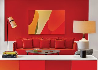 """In Situ Design and Lilian B Interiors adapted a six-story brownstone in midtown Manhattan into a boutique hotel with 33 guest suites. Each floor received what the designers call a """"visceral"""" color treatment using Benjamin Moore paints, including Outrageous Orange."""