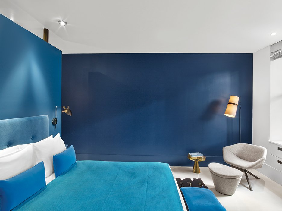 The artists used Old Navy paint from Benjamin Moore to give this guest room a blue hue.  Hospitality Favorites from The William