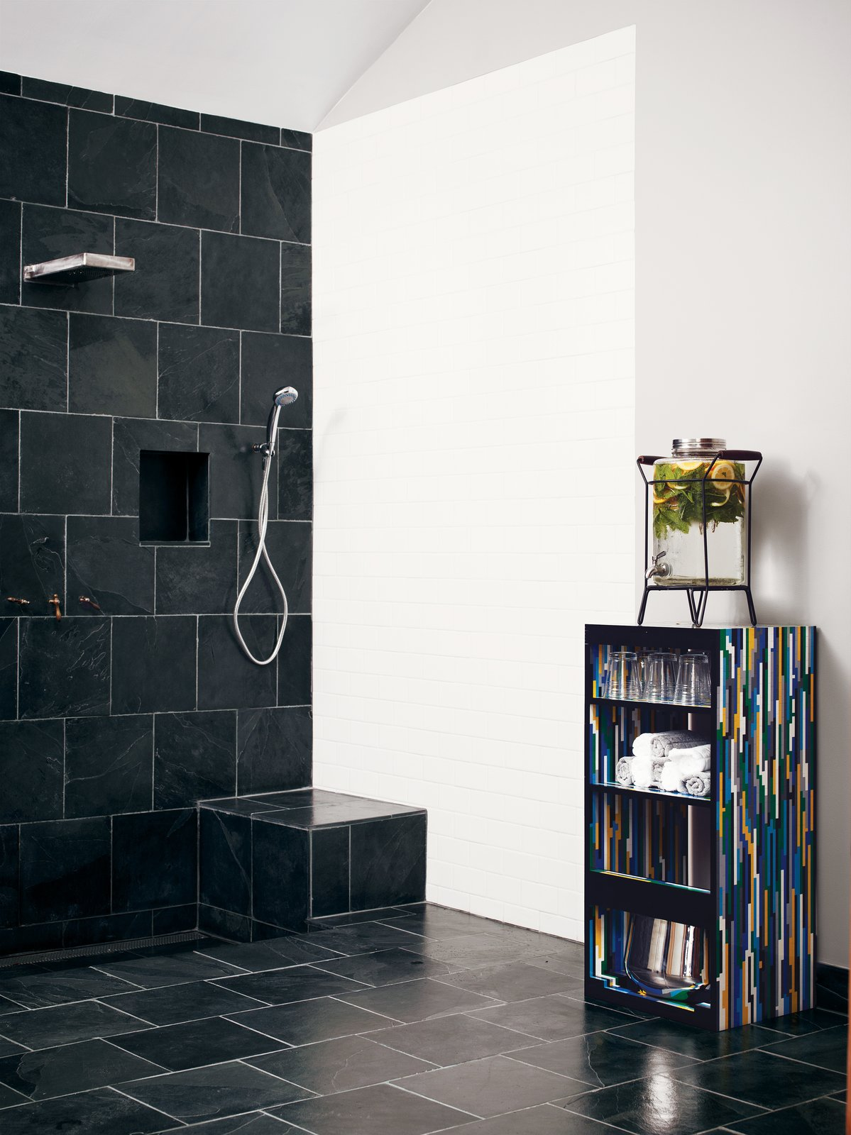 Bath Room and Open Shower Roberts found the Montauk black slate, which he continued in a second bath.  Loft