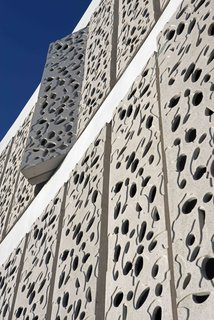 The pattern on the panels, which can be opened or closed, was inspired by a coral reef. The exterior shell acts as a sun screen that helps keep the structure cool.