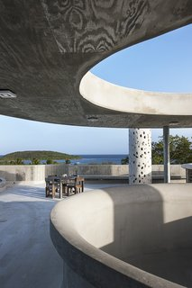 El Blok, a 22-room hotel in Vieques, Puerto Rico, strikes a unique profile. Its meandering shape features numerous cut-outs that let light in, casting playful shadows. The LEED Gold-certified property, designed by San Juan-based firm Fuster + Architects, shows the texture of the plywood boards that were used to create the building's framework.