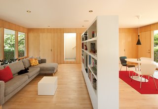 Waechter designed the custom bookshelf, which Oakley uses to define distinct spaces for living and dining.