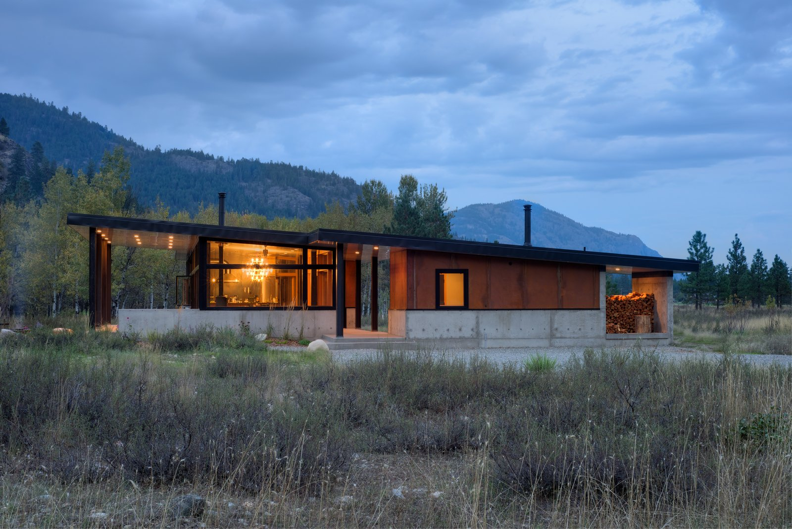 The house is divided in two: on the left, the main house consists of an expansive kitchen, living, and dining space, plus sleeping accommodations. On the right, a smaller structure holds a sauna, shower, and ski wax room. The house's length is oriented along an east/west axis to maximize strong southern light and provide views of an aspen grove.  Cabins & Hideouts from Modern Mountain Retreat in Washington