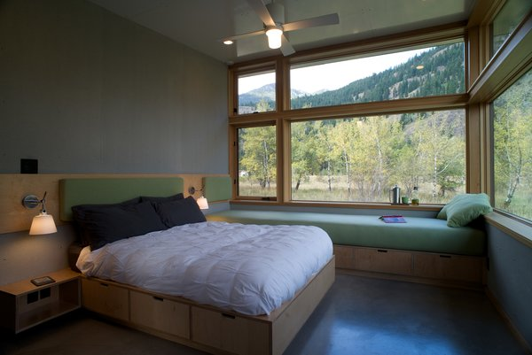 Lastly, a master bedroom opens up to the landscape around it and can sleep an extra two guests on day beds.