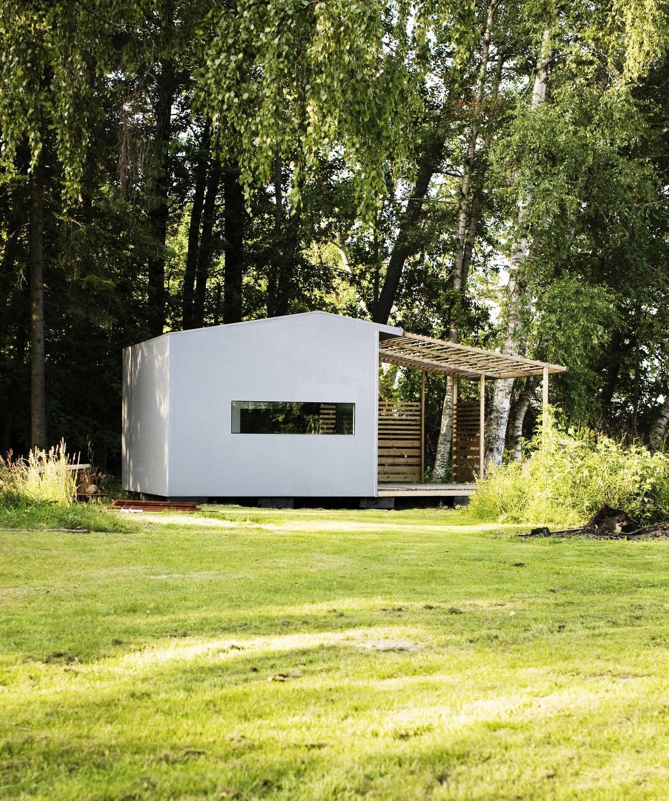 Exterior, House Building Type, Wood Siding Material, Gable RoofLine, and Prefab Building Type The homes are painted wood, and include a shaded deck space, plus full insulation and electricity, for a price of about $29,000.  Tiny Homes from Tiny Prefabricated House Can Be Built in Two Days