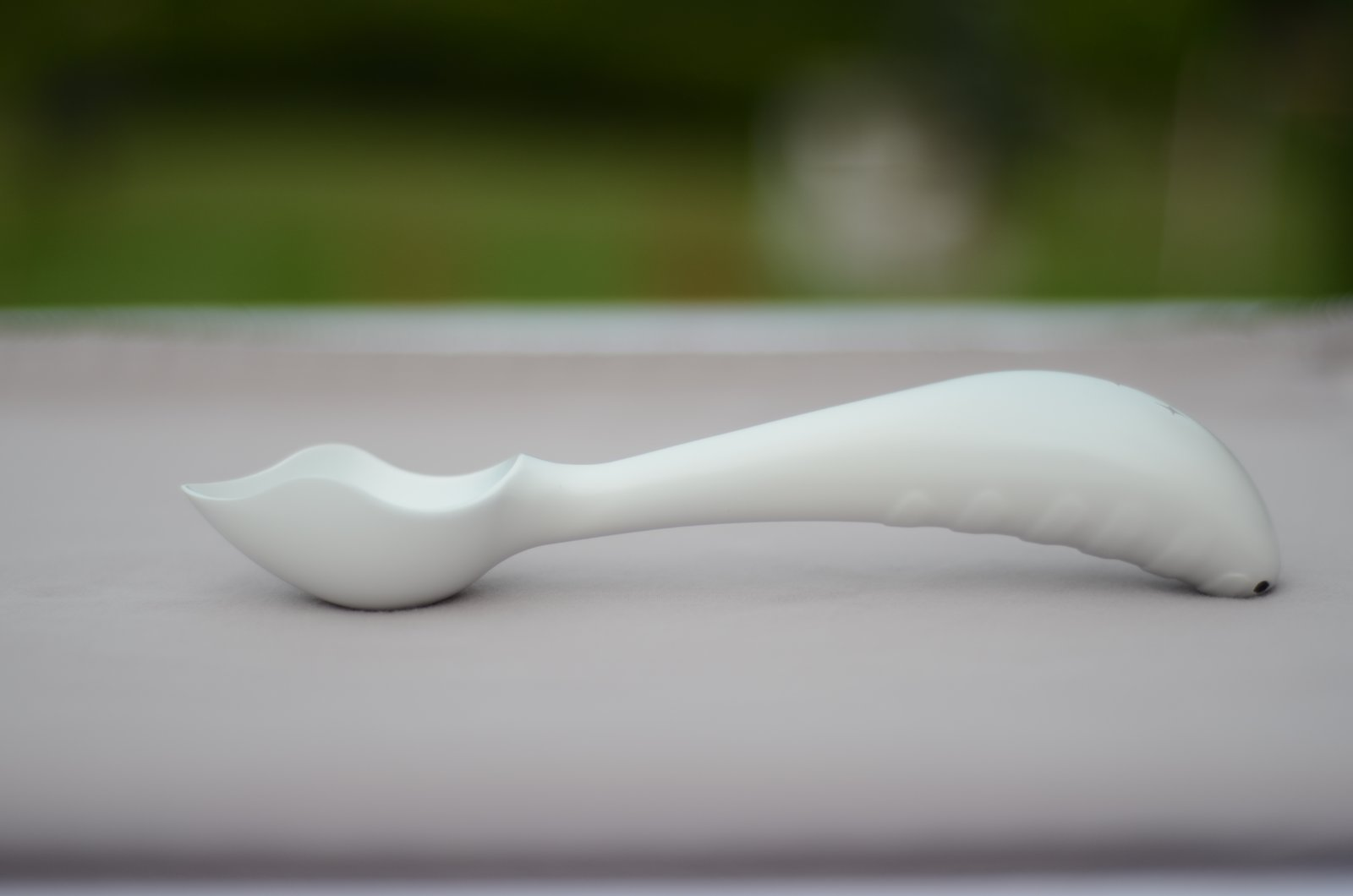 Creator Michael Chou took the ergonomically flawed design of the typical ice cream scoop, and angled it and added a grip so that it takes less effort to use. Chou, a 35-year-old father and aerospace engineer from Michigan, went through 38 iterations over two years of development before settling on the design.  The World's First Ergonomic Ice Cream Scoop? by Alexander George