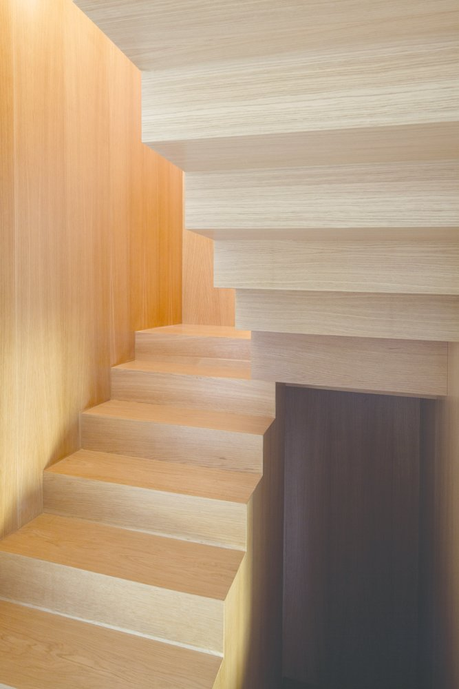 The streamlined elm stairwell connects three levels of living space, from the public living areas to the mezzanine, situated to take advantage of city vistas, and the uppermost private quarters.  190+ Best Modern Staircase Ideas from Modern Staircase Inspiration