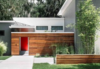 An enclosed courtyard, bordred by ipe, is arguably the most distinctive feature of the house that the Phil Kean Design Group created for Adriana De Azevedo, Daniel Coelho, and their two daughters in Winter Park, Florida.