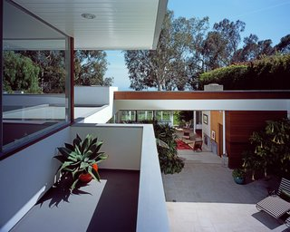 "The original house opens completely to the repaved pool deck, which leads to the upstairs addition. ""Working on the house had only increased our respect for Neutra, whom we had always admired greatly,"" says Grueneisen. ""So we knew that any major additions would have to be respectful to his design."""