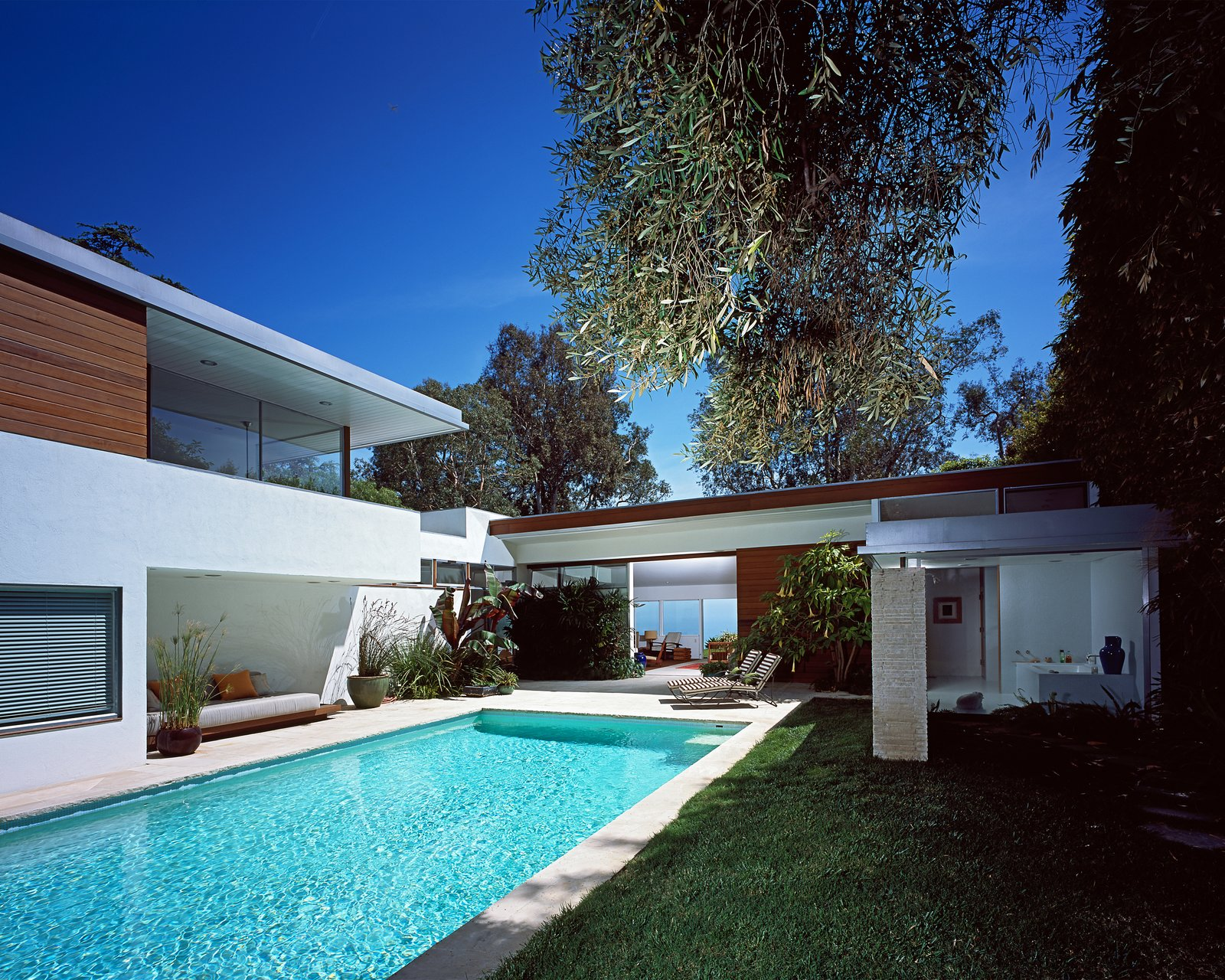 "Outdoor The addition references the main house in materiality and function. ""We did not want to simply copy the existing elements, so we explored and investigated different levels of faithfulness to the existing structure, from a very near emulation to a much more contemporary approach that would only quote the previous architecture in some key aspects,"" Grueneisen says.  Renovations from A Neutra Renovation in Los Angeles"