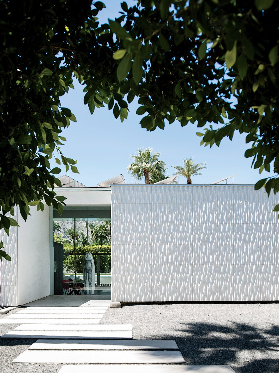 Home with white facade made of textured ceramic tiles