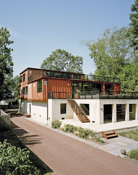 "Purchasing a lot off the Delaware River in Pennsylvania, Martha Moseley and Bill Mathesius adapted an unused concrete foundation—remnants of its previous owner's abandoned plans—to create a home that's uniquely their own. ""We were inspired by the site, and our desire to have something cool and different,"" says Moseley."