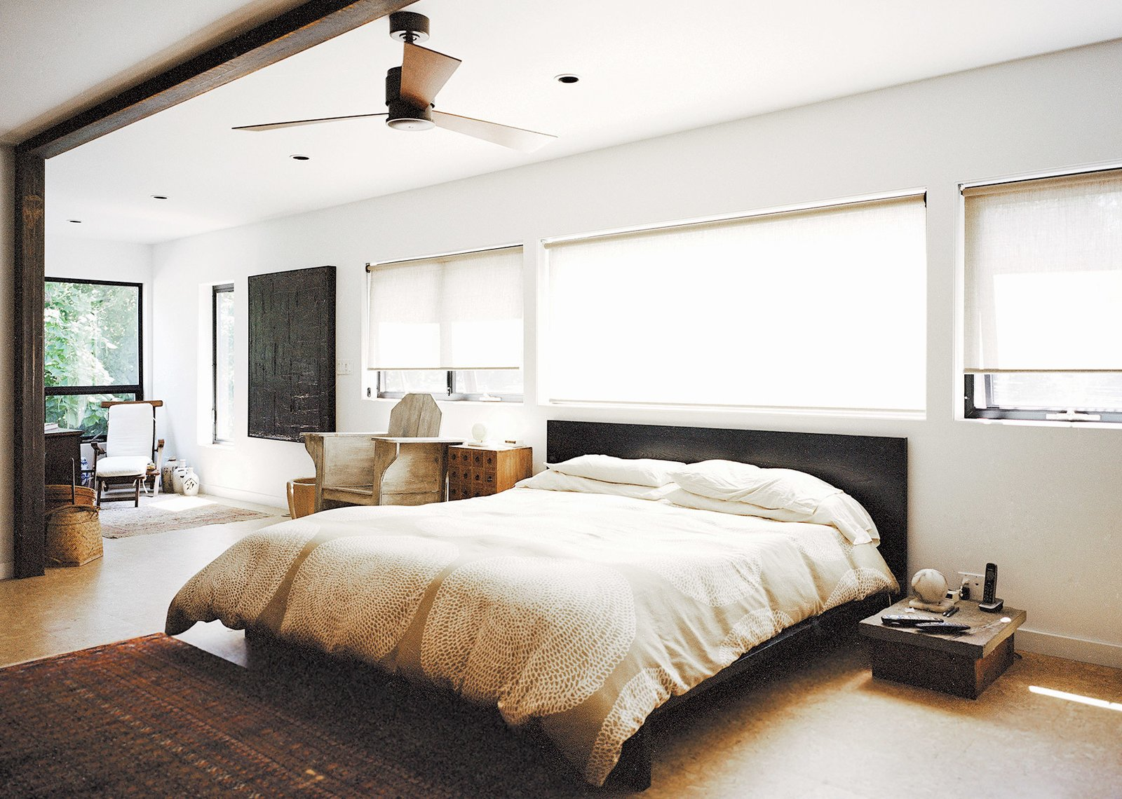 Bedroom and Bed In the master bedroom, a custom bed by Jason Micciche is outfitted with linens from Marimekko; the ceiling fan is by Fanimation.  Photo 7 of 12 in A Shipping Container Home in Pennsylvania Embraces Its Rugged Industrial Origins