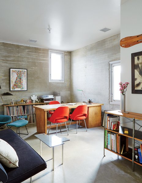 The office is a showcase that includes an Eames Storage Unit for Herman Miller, a wall-mounted Eames leg splint, and chairs by Eero Saarinen and Harry Bertoia for Knoll.