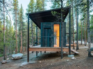 "The Outward Bound cabins' steel frames lift the structures above a three-foot snowpack while supporting corrugated-steel ""snow roofs."""