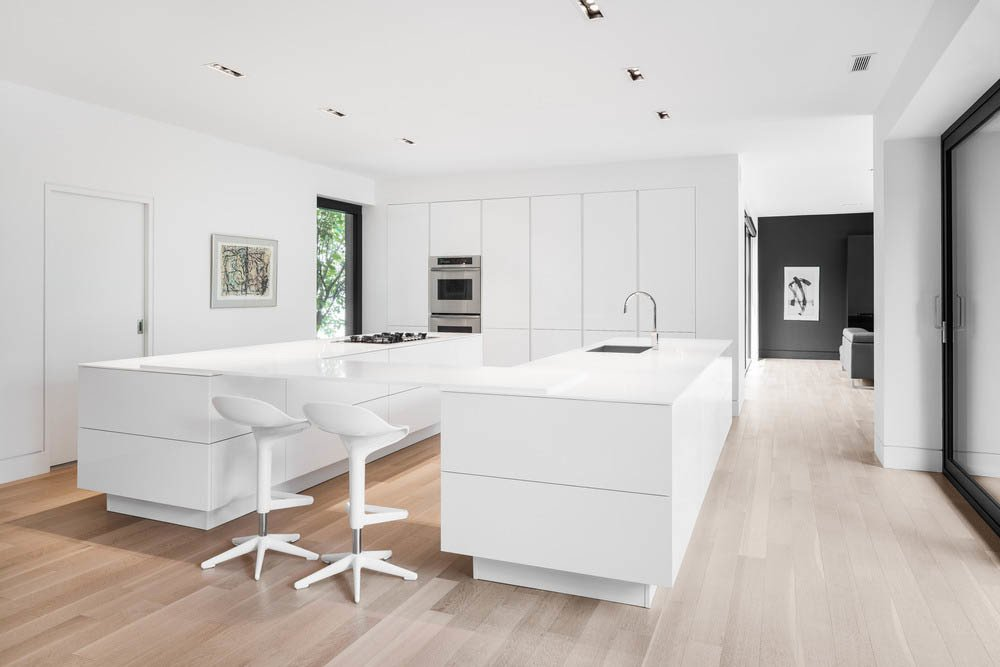Kitchen, White Cabinet, and Light Hardwood Floor White was used extensively throughout the addition, a choice that the architects say enhances the spacious feel of the rooms and draws attention to the views.  Prince-Philip Residence by William Lamb from Airy Kitchen Additions