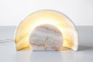 Carved Sunset Lamp by Alban Le Henry for Great Design Gallery, $4,370 at larcobaleno.com  Calacatta marble or alabaster is carved with CNC to form a precise arc, from which an LED light emits a soft glow. More than a lamp, it's art for your tabletop, and available in very limited editions from a commission by Great Design Gallery in Paris.