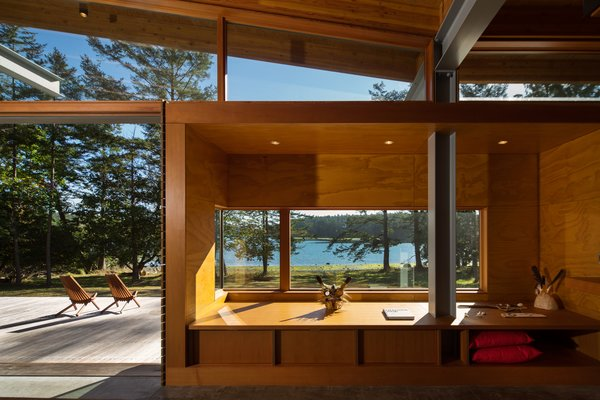 Living Room Bay and clerestory windows from Window Craft abound throughout.  Shining Examples of Clerestory Windows by Luke Hopping from An Off-the-Grid Island Home for a Seattle Music Producer