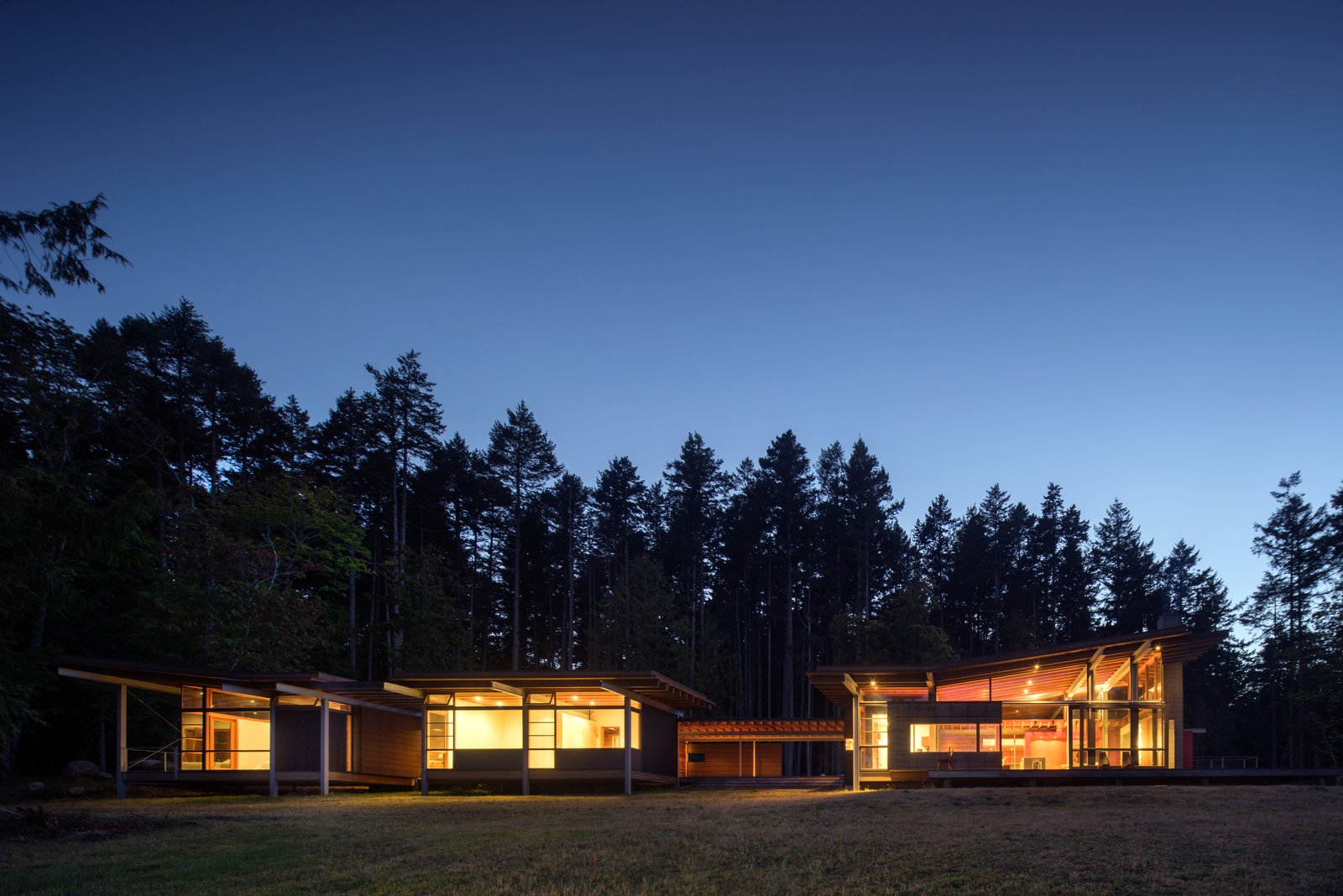 Exterior The house glows at night.  Photo 14 of 16 in An Off-the-Grid Island Home for a Seattle Music Producer