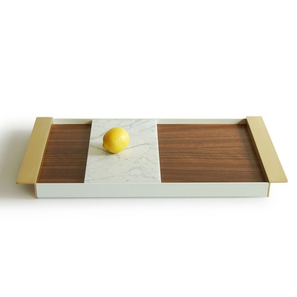 The Perimeter Tray from Ladies & Gentleman Studio is an expression of the possibilities of materials. Using walnut or oak wood, Carrara marble, brass, and powder-coated aluminum, this tray is an eye-catching accessory that the entertainer on your holiday list will be happy to show off.