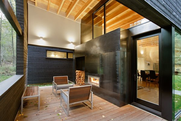 After years of visiting the area as vacationers, one couple builds this striking home for their retirement outside Greenwater, Washington. A fireplace can be used on the rear patio and in the living room, making it feel like one cohesive space. Ipe planks, the same wood that's used in the front courtyard, cover the floor.