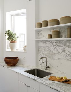 This Brooklyn kitchen pairs a stunning Borghini honed marble countertop and backsplash by Ann Sacks.
