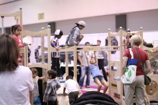 No, this isn't day care—it's the Modern Family zone on the show floor in which families tested out the latest play houses and jungle gyms for the youngest of modernists.