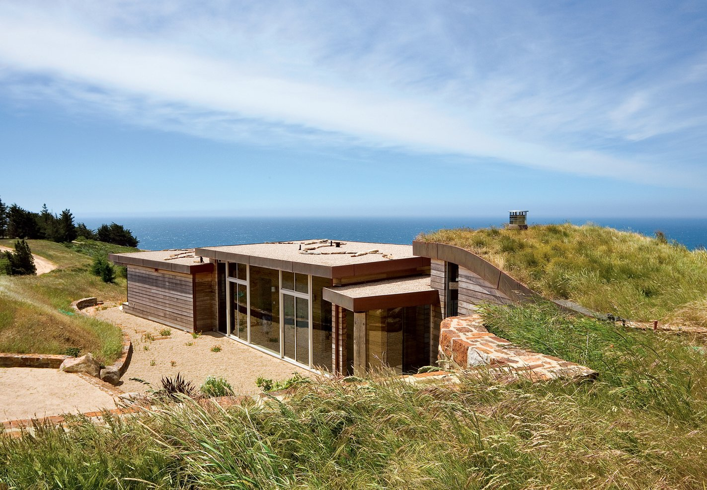 """I've been all around the world, and whenever I come back here, I realize that the Pacific Ocean seen from those cliffs is the most beautiful view on earth,"" says the resident of this house built into a hillside in Big Sur, California.  Homes with a Waterfront View by Diana Budds"