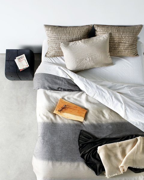 Side table by Urban Hardwoods, Rustic Wood serving tray by Grayworks Design, Crushed Silk shams by Eileen Fisher for Garnet Hill, Egg Press Dot sheet set by Schoolhouse Electric & Supply Co., City throw by Bryce & Co., Ines Duvet cover by Area.