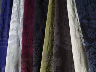 The fabric family's signature is Mepal (shown here), a large-scale silk-and-damask textile design.