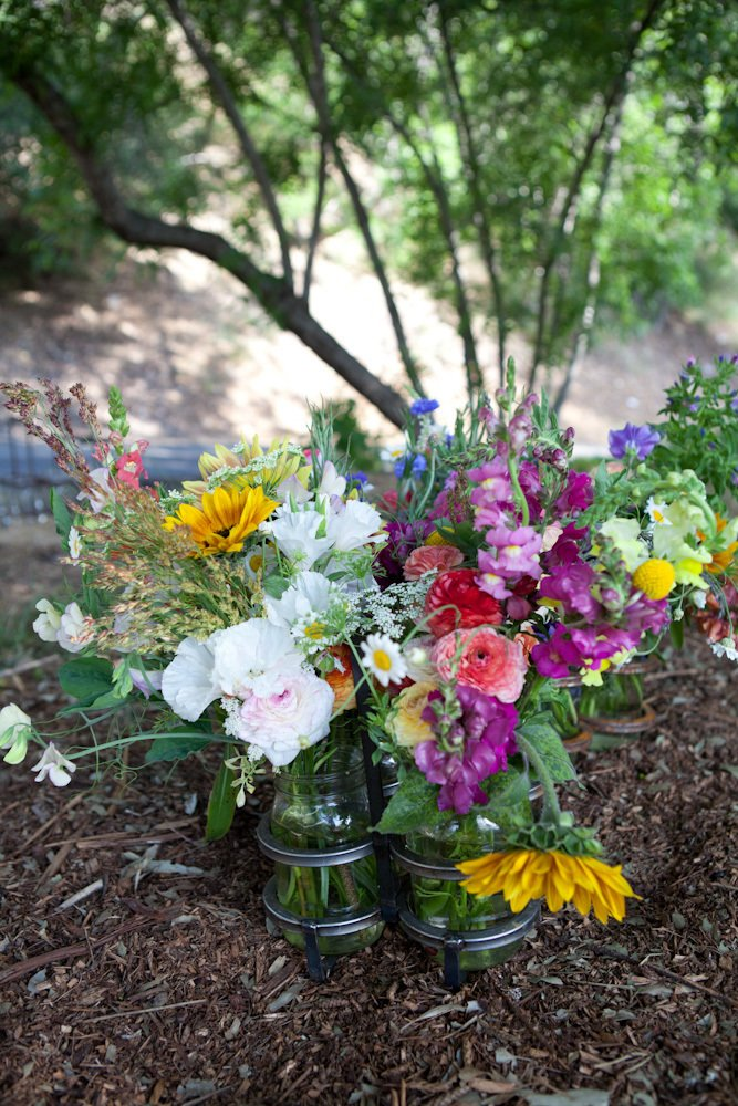 The fruits of their labors: beautiful cut flowers, which Silverlake Farms sells at local farmers' markets in signature iron-and-glass jars.  Photo 21 of 21 in L-Shaped Indoor-Outdoor LA Home