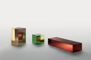 """Boxy, for Glas Italia, 2011  Glas Italia """"has this amazing possibility to make a mirror out of any color of glass,"""" says Grawunder. Using that material as a starting point, Grawunder turned the mirrors into boxes and then sanded off their silver backing at the corners, allowing light to emanate from the colored glass. She envisions these """"hybrid objects""""—a combination of light-table-storage—to be used as mini bars or bedside tables that hold books."""